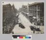 Parade down a city street. [photographic print]