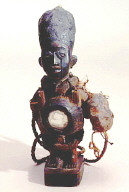 Yombe (West Zaire) standing male figure with mirror in abdomen