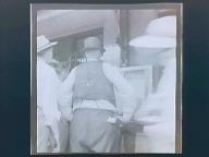 Wartime in DesMoines, Iowa Farmer in Town