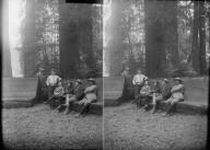 Men sitting on log bench, Bohemian Grove. [negative]