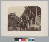 Group of seven men on porch of building. [photographic print]