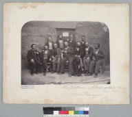 """""""La Victoria, nitrate of soda works in 1863, near Pisagua, Peru,"""" group portrait of men in front of building. [photographic print]"""