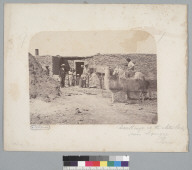 """""""Dwellings at the nitre works near Iquique, Peru [Chile],"""" with men, women and children. [photographic print]"""
