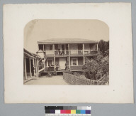 Two story house with people on balconies of both stories. [photographic print]
