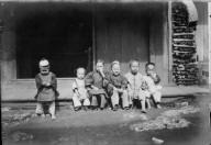 Chinese Children sitting on boardwalk, Monterey. [transparency]