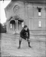 """Hopper, [James], U.C. football, 1899,"" standing in front of Harmon Gymnasium, University of California at Berkeley. [negative]"