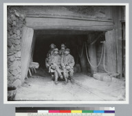 Four miners on flatbed car at face of Tunnel No. 9, Sierra Buttes Mine, California. [photographic print]