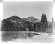 Donner Lake, California, with snowsheds, fisherman and photographer. [transparency]