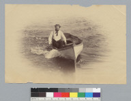 Emerald (yacht) crew member in small boat. [photographic print]