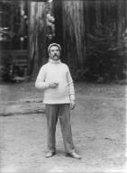 Man holding cigar, Bohemian Grove. [negative]