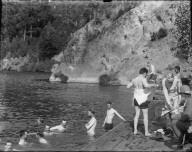 Men swimming and on platform, Bohemian Grove. [negative]