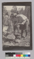 Two men cooking outdoors, Glen Alpine trip. [photographic print]