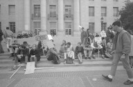 Picketers sitting on Sproul Steps.