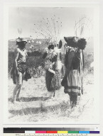 Left to right: head dancer, dancer with maple-fiber skirt and Sahte