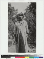 Old woman standing with kerchief on head