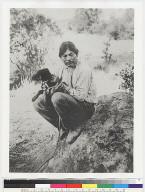 Capt. Eph on rock with dog