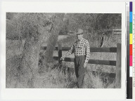 """View of """"Ishi Site;"""" man in checkered shirt pointing"""