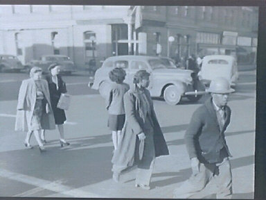Consumers - the 10th St. Market in Oakland, March 1943. War pay checks