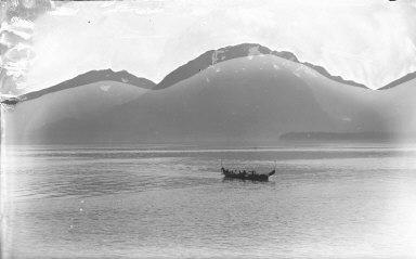 """Douglas Island Mountain from Juneau"" with native boat, Alaska. [negative]"