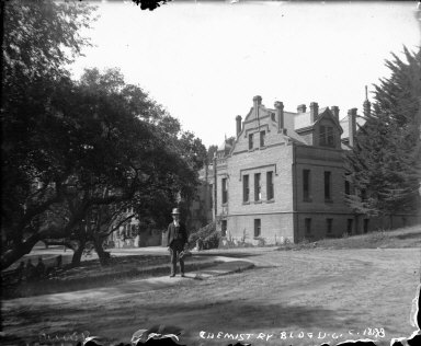 """Chemistry Bldg., U.C., ca. 1898,"" with a male student, University of California at Berkeley. [negative]"