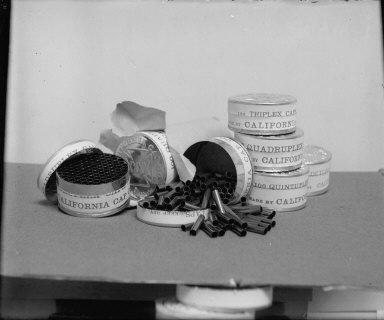 Triplex caps and storage tins, California Cap Company. [negative]