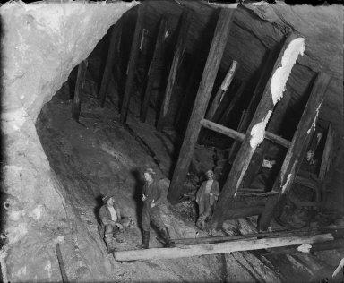 Three men in timbered shaft. [negative]