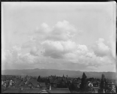 Clouds and bird's-eye view of residential section, Oakland. [negative]