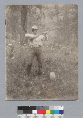 Man [Roland L. Oliver?] shooting a gun, Idaho trip. [photographic print]