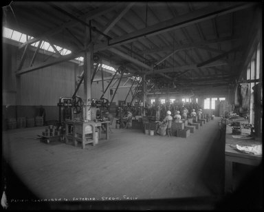 Factory interior with laborers, Pacific Cartridge Company, Stege, California. [negative]