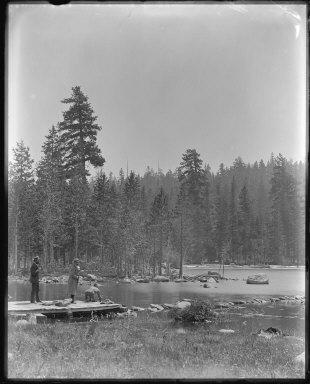 Three men at edge of Independence Lake, California. [negative]