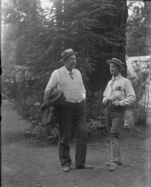 Two men wearing straw hats, Bohemian Grove. [negative]