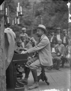 Man playing organ, Bohemian Grove. [negative]