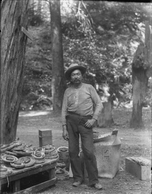 Man with paper lanterns, Bohemian Grove. [negative]