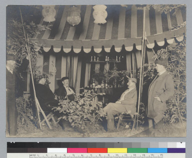 Night scene of five men in front of tent with bar, [photographic print]