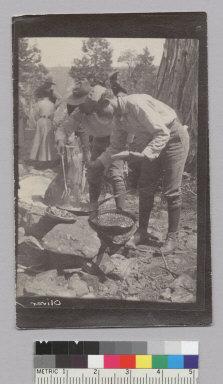 Two men cooking outdoors, Glen Alpine trip. [photographic print]