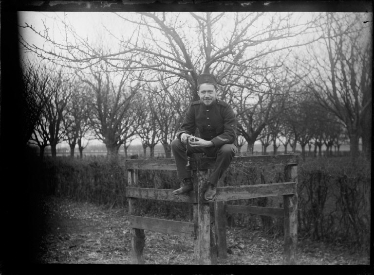 119159, [Man sitting on fence.] [negative]